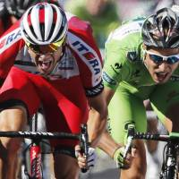 Narrow victory: Norway's Alexander Kristoff (left) outsprints Slovakia's Peter Sagan to win the 12th stage of the Tour de France on Thursday. Kristoff won in 4 hours, 32 minutes, 11 seconds. | AP