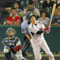 That's out of here: Yakult's Tetsuto Yamada has started to tap into his power at the plate in recent weeks.   KYODO