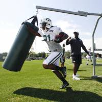 First-class ticket: Jets running back Chris Johnson takes part in a drill during training camp. | AP