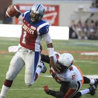 Another chance: Former Heisman Trophy winner Troy Smith, now playing QB for the Montreal Alouettes, has extended his pro career in the Canadian Football League. | REUTERS