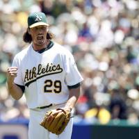 A-OK: Athletics pitcher Jeff Samardzija pumps his fist during Oakland's 4-2 win over Toronto on Sunday. | REUTERS/USA TODAY SPORTS