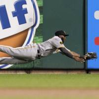 Nice grab: Pittsburgh's Josh Harrison makes a diving catch against St. Louis in the second inning on Monday night. The Cardinals beat the Pirates 2-0. | AP
