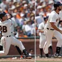 Grand old time: Giants catcher Buster Posey (left) hits a grand slam against the Diamondbacks during the fifth inning on Sunday in San Francisco. Giants pitcher Madison Bumgarner (right) helps his own cause with a grand slam in the sixth inning. | AP
