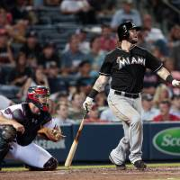 Off the hook: The Marlins' Jarrod Saltalamacchia drives in the tiebreaking run in the top of the ninth on Thursday. | AP