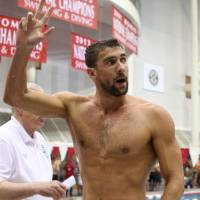 Comeback trail: Michael Phelps waves to the crowd after the Bulldog Grand Slam on Sunday night in Athens, Georgia. | REUTERS/USA TODAY SPORTS