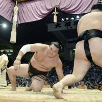 Nobody's perfect: Hakuho (left) gets to his feet after losing to Goeido at the Nagoya Grand Sumo Tournament on Wednesday. | KYODO