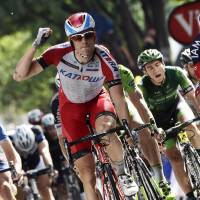 Burning rubber: Alexander Kristoff pumps his fist as he crosses the finish line to win Stage 15 on Sunday. | AFP-JIJI