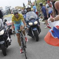 Everyone is watching: Tour de France leader Vincenzo Nibali rides in the middle of onlookers and media members during the 18th stage of the Tour de France on Thursday. Nibali won the stage in dominant fashion to help pad his overall lead in the race. | AP