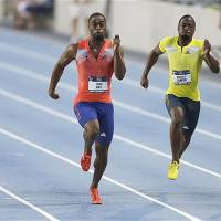 Need for speed: Americans Justin Gatlin (left) and Tyson Gay were set to battle again in the 200 meters on Friday night at the Diamond League meet in Monte Carlo. | AP