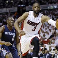 Not going anywhere: Miami Heat guard Dwyane Wade signed a new two-year contract with the team on Tuesday. | AP
