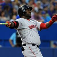 Two jacks: Boston's David Ortiz watches his second two-run homer against Toronto leave the yard on Monday night. | REUTERS/USA TODAY SPORTS