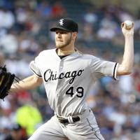 Fans 12 in win: Chicago's Chris Sale throws a pitch against Minnesota in the first inning on Saturday. | AP