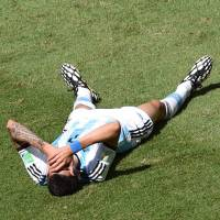 Sit this one out: Argentina midfielder Angel Di Maria will miss his team's World Cup semifinal match against the Netherlands after suffering a thigh injury during the quarterfinals. | AFP-JIJI