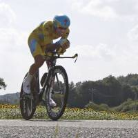 Almost there: Italy's Vincenzo Nibali competes in a time trial on the penultimate day of the Tour de France on Saturday. Nibali leads the race by 7 minutes, 52 seconds. | REUTERS
