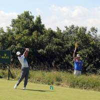 Solid start: Tiger Woods tees off on the 11th hole in the first round of the British Open on Thursday at Royal Liverpool. | AFP-JIJI