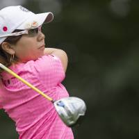 At the start: Mika Miyazato tees off during the first round of the LGPA International Crown at Caves Valley Golf Club in Owings Mills, Maryland, on Thursday.  | AFP-JIJI