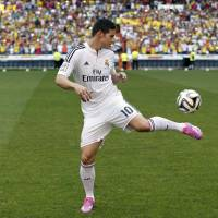 Money in the bank: James Rodriguez juggles a ball during his presentation as a Real Madrid player on Tuesday. | AP