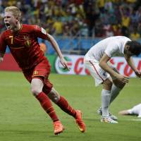 There can be only one: Belgium's Kevin De Bruyne runs toward the bench to celebrate after scoring the tie-breaking goal during the first half of extra time against the U.S during their World Cup match on Tuesday. Belgium won 2-1. | AP