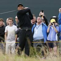 Open for business: Tiger Woods watches his tee shot on the seventh hole on Tuesday during a practice round ahead of the British Open, which begins Thursday in Hoylake, England. | REUTERS