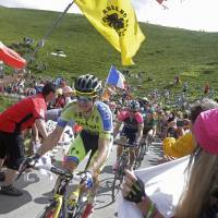Best seat in the house: Michael Rogers leads a group of riders through a throng of fans during the 15th stage of the Tour de France on Tuesday. Rogers went on to win the stage. | AP