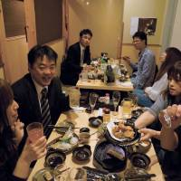 Cupid aims his arrow at loveless Tokyo drinkers