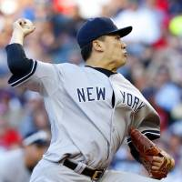 Getting knocked around: Yankees starter Masahiro Tanaka delivers a pitch against the Indians during their game on Tuesday in Cleveland. New York lost 5-3. | KYODO