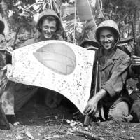 Trophy: U.S. troops hold a Japanese flag captured in July 1944 during the Battle of Saipan.   KYODO
