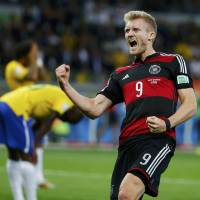 Over before it began: Germany forward Andre Schuerrle celebrates after scoring against Brazil during their World Cup semifinal match on Tuesday. | REUTERS