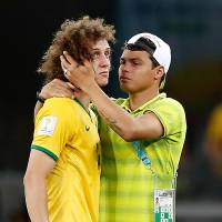 Brazil defender David Luiz is comforted by teammate Thiago Silva. | AFP-JIJI