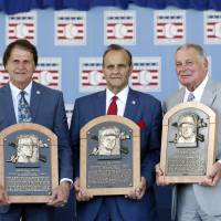 Pushed all the right buttons: Former managers Tony La Russa (left), Joe Torre (center) and Bobby Cox were inducted into the National Baseball Hall of Fame on Sunday. | AP