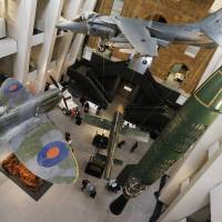 A Spitfire fighter plane, Harrier jump jet and V-1 rocket are suspended from the museum's ceiling. | REUTERS