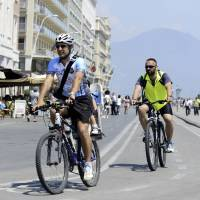 Easy rider: Bike Tour Napoli founder Luca Simeone (left) pedals along a cycling lane in Naples, Italy, in June. | AP