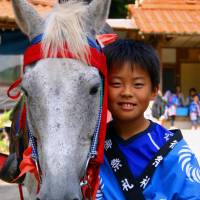 Horse whisperer: A young boy in Yabusame, with the white steed that will be used in an archery festival. | ANGELES MARIN CABELLO