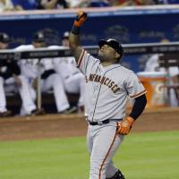 Reach for the sky: The Giants' Pablo Sandoval celebrates after his home run against the Marlins on Friday. The Giants won 9-1. | AP