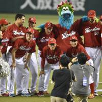 All together now: The sizable Hiroshima Carp contingent made its presence felt during the 2014 NPB All-Star series. | KYODO