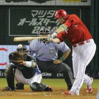 Catch of the day: The Carp's Brad Eldred drove in four runs in Game 1 of the NPB All-Star Series. | KYODO