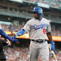 Puig runs wild in Dodgers' victory