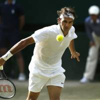 Special vintage: Roger Federer plays a shot during his Wimbledon semifinal win over Milos Raonic on Friday.   AP