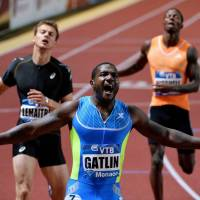 Untouchable: Justin Gatlin reacts as he crosses the finish line first to win the men's 200-meter race on Friday in Monte Carlo. Gatlin won in a season-best time of 19.68 seconds. Rival sprinter Tyson Gay was fourth. | REUTERS