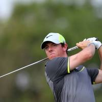 Fore!: Rory McIlroy watches his shot from the eighth tee during the second round of the British Open on Friday. | AFP-JIJI