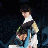 As one: Macbeth (Mansai Nomura) embraces Lady Macbeth (Natsuko Akiyama) in Nomura's version of the Bard's Scottish play. | YOSHINORI MIDO/COURTESY OF SETAGAYA PUBLIC THEATRE