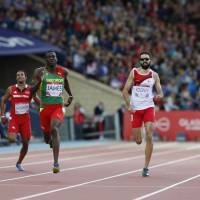 Sublime sprint: Grenada's Kirani James (center) heads for the finish line in the 400 meters at the Commonwealth Games in Glasgow on Wednesday. James won in a time of 44.24 seconds. | AFP-JIJI