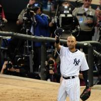 The shortstop, No. 2, Derek Jeter, No. 2: New York Yankees star Derek Jeter waves to the crowd during the MLB All-Star Game on Tuesday in Minneapolis. | REUTERS