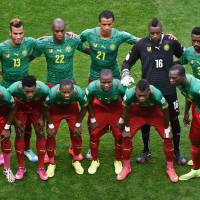 Searching for truth: Cameroon's national team poses for photos before facing Brazil in its final match at the 2014 World Cup on Monday.   AFP-JIJI