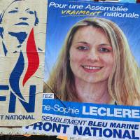 An election poster for French far-right National Front (FN) party candidate Anne-Sophie Leclere is displayed in Rethel, northeastern France, last Oct. 18. | AFP-JIJI