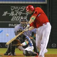 Star attraction: Carp slugger Brad Eldred belts a two-run home run in the seventh inning in Game 1 of the NPB All-Star Series on Friday at Seibu Dome. The Central League beat the Pacific League 7-0. | KYODO