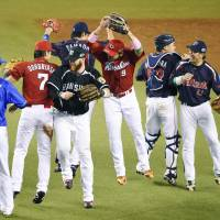 Happy ending: Central League All-Stars congratulate one another after winning Game 1 of the All-Star Series on Friday night at Seibu Dome.  | KYODO