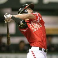 Seventh heaven: Fukuoka Softbank's Yuki Yanagita hits a home run in the sixth inning of the Hawks' 7-0 win over the Marines on Thursday. | KYODO