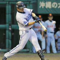 Flying start: Yokohama's Taketoshi Goto hits a three-run home run in the first inning of the BayStars' 3-0 win over the Giants in Naha on Wednesday. | KYODO