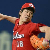 Back on track: Hiroshima starting pitcher Kenta Maeda delivers during the Carp's 3-1 win over the Dragons at Nagoya Dome on Saturday. | KYODO